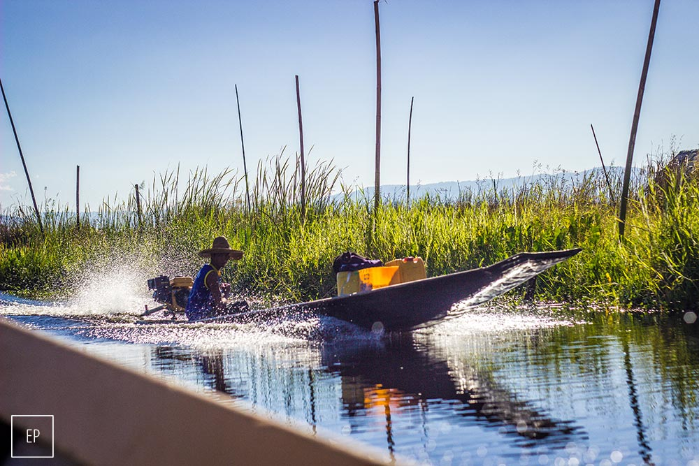 Boater delivering supplies across Inle Lake, Myanmar